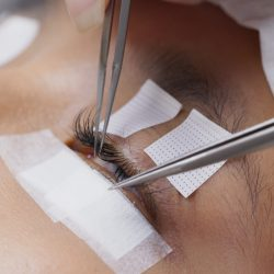 Asian woman with eyelash extension in beauty salon